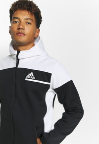 adidas Performance - HOODIE PRIMEGREEN HOODED TRACK TOP - Zip-up hoodie - black/white - 3