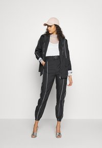 Missguided - CODE CREATE JACKET WITH REFLECTIVE PIPING - Bomber Jacket - black - 1