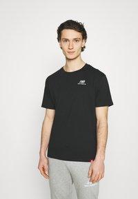 New Balance - ESSENTIALS EMBROIDERED TEE - Basic T-shirt - black - 0