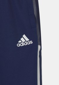 adidas Performance - TIRO UNISEX - Tracksuit bottoms - team navy blue - 2