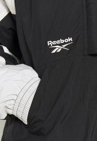 Reebok Classic - TWIN PUFF JACKET - Winter jacket - black