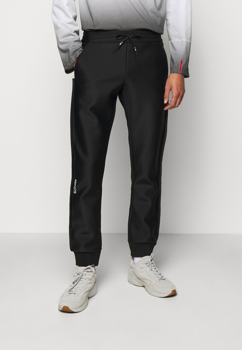 F_WD - Tracksuit bottoms - black