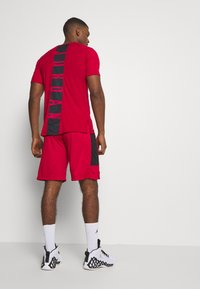 Jordan - AIR DRY SHORT - Sports shorts - gym red/black/black - 2