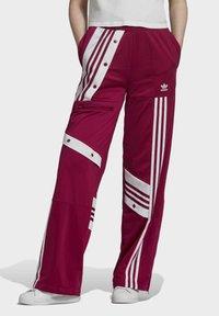 adidas Originals - DANIËLLE CATHARI JOGGERS - Joggebukse - purple - 0