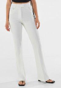 Bershka - Trousers - white - 0
