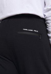 KARL LAGERFELD - PANTS - Tracksuit bottoms - navy - 3