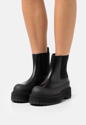 KILAS - Platform ankle boots - black