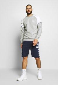 Hummel - HMLXANDER SHORTS - Sports shorts - black iris - 1