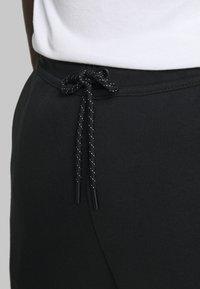 Nike Sportswear - M NSW TCH FLC JGGR - Tracksuit bottoms - black - 3