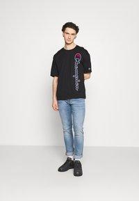 Champion Rochester - Print T-shirt - black - 1