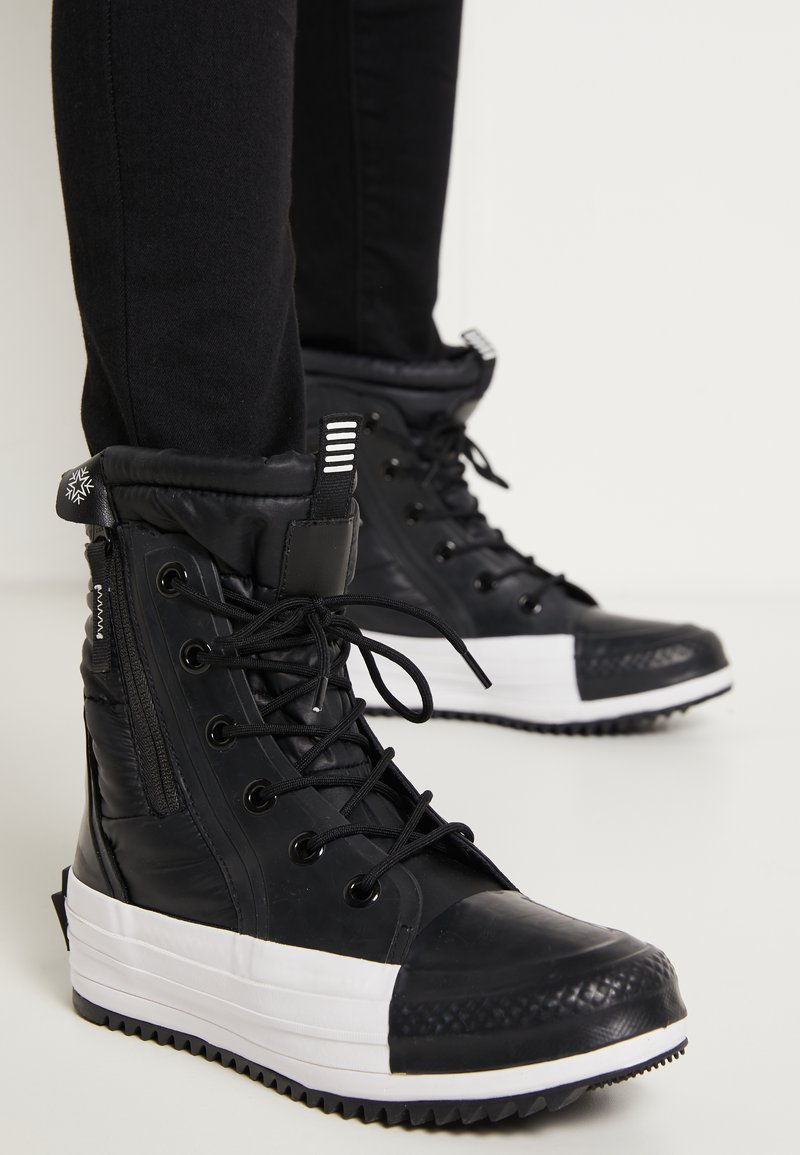 Converse - CHUCK TAYLOR ALL STAR - Winter boots - black/white