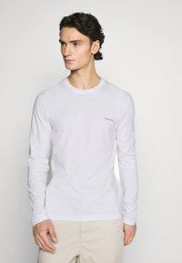 Calvin Klein - LONG SLEEVE LOGO 2 PACK - T-shirt à manches longues - black/white - 2