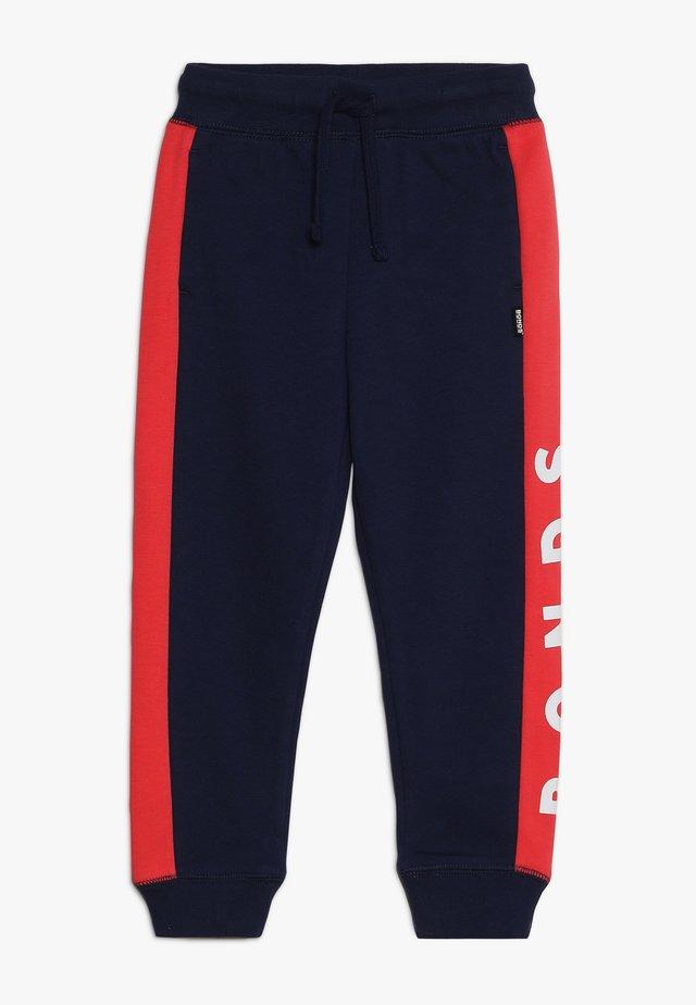 COOL TRACKIE - Pantalon de survêtement - black sea/unicornicopia