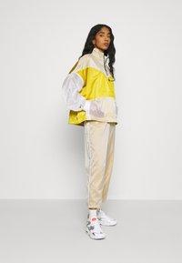 Nike Sportswear - PANT - Tracksuit bottoms - dark citron/white/black - 1