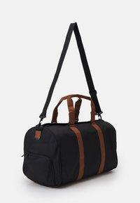 Herschel - NOVEL UNISEX - Weekend bag - black - 1