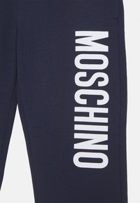 MOSCHINO - Tracksuit bottoms - blue navy - 2