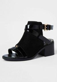 River Island - Ankle strap ballet pumps - black - 1