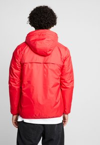 K-Way - UNISEX CLAUDE ORESETTO - Light jacket - red - 2