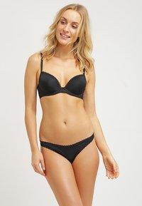 Calvin Klein Underwear - SEDUCTIVE COMFORT THONG - Tanga - black - 1