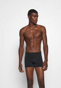 Puma - CLASSIC SWIM TRUNK - Costume da bagno - black - 0