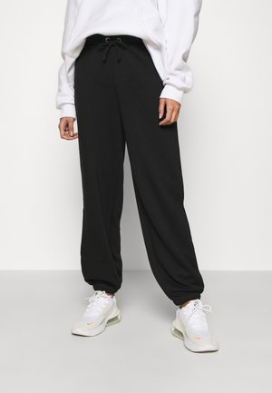 DRAWSTRING  - Tracksuit bottoms - black