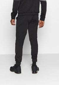 Puma - RETRO TRACK SUIT - Survêtement - black - 4