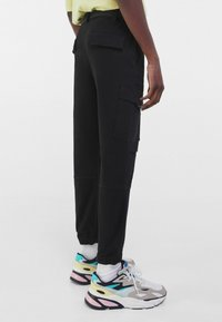 Bershka - Cargo trousers - black - 2