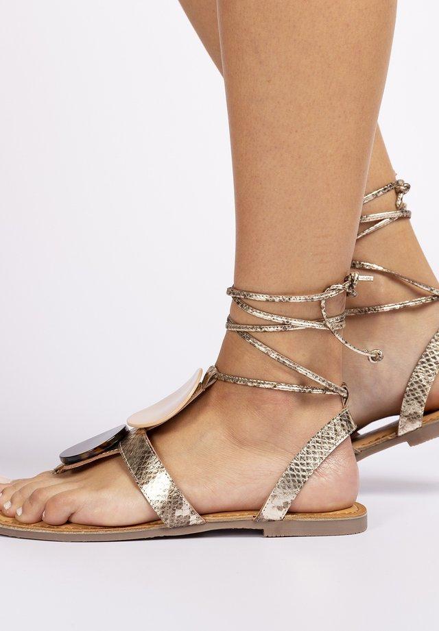 Sandalias de dedo - oro