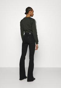 Liu Jo Jeans - BEAT  - Vaqueros bootcut - black - 2
