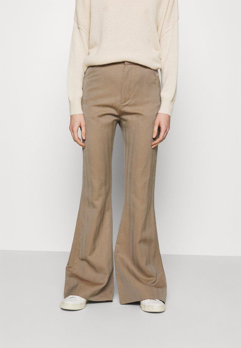 Hope - FLARE TROUSERS - Trousers - beige herringbone