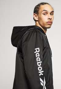 Reebok Classic - VECTOR WINDBREAKER - Summer jacket - black - 3