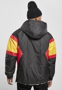 Starter - Outdoor jacket - blk/wht/starter red/golden - 2