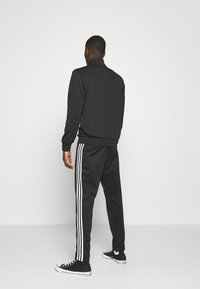 adidas Originals - ESSENTIAL UNISEX - Training jacket - black - 2