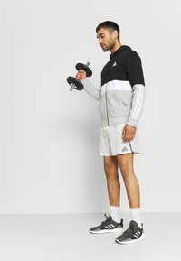 adidas Performance - COLORBLOCK FULL ZIP ESSENTIALS - Zip-up sweatshirt - black/white - 1