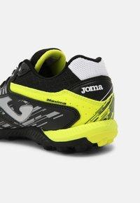 Joma - MAXIMA - Astro turf trainers - black/yellow - 4