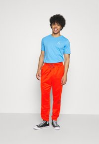 Jordan - PANT - Tracksuit bottoms - chile red/black - 1