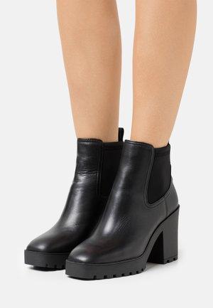 CHETTA - Platform ankle boots - black