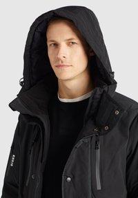 khujo - NANDU - Winter jacket - schwarz-schwarz kombo - 6