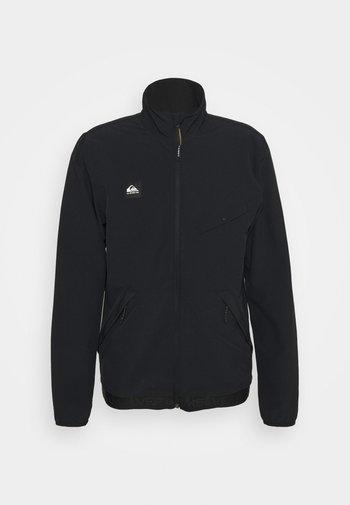 CROSS OVER - Soft shell jacket - black