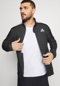 adidas Performance - MARATHON - Sports jacket - black/white - 4