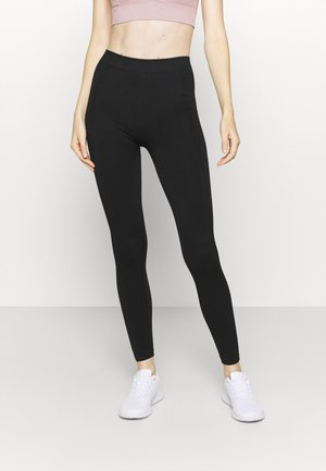 ONPONITA CIRCULAR - Leggings - black