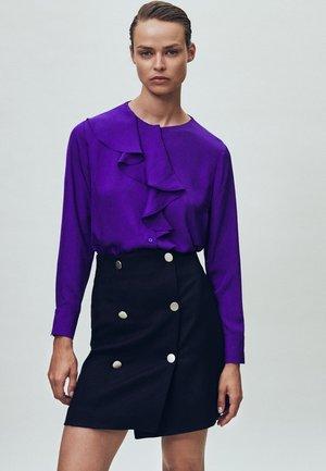 MIT VOLANTS  - Blouse - dark purple