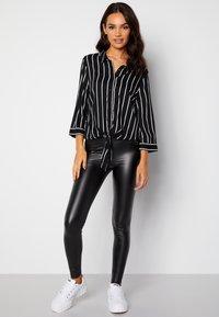 Bubbleroom - JULIETTE SS KNOT - Button-down blouse - black - 1