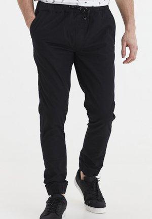 SINAN - Spodnie materiałowe - black