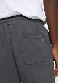 YOURTURN - Loose Fit UNISEX - Tracksuit bottoms - dark grey - 5