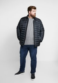 Calvin Klein - LIGHT DOWN LINER - Light jacket - black - 1