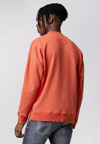 Tigha - Sweatshirt - sunrise orange - 2