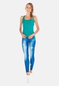 Winshape - HWL102 INDIGO-BLUE HIGH WAIST -TIGHTS - Leggings - ocean blue - 2