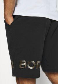 Björn Borg - MEDAL SHORTS - Sports shorts - black gold - 3