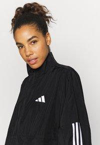 adidas Performance - COVER UP - Training jacket - black - 4